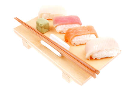 maguro: Japanese Cuisine - Different Types of Nigiri Sushi : Tuna (maguro) Salmon (sake) and Eel (unagi) with Wasabi on wooden plate isolated over white background