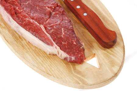 beefsteak: raw meat beefsteak fillet with knife on wood isolated over white background Stock Photo