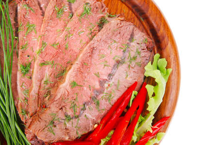 cebollines: grilled beef slice on wooden plate over white
