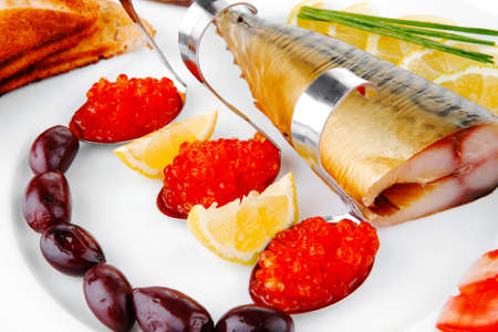diet food - red caviar and smoked mackerel fish with lemon tomatoes and bread on white china plate isolated over white background Stock Photo