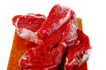 raw steak ready to prepare on cut board with cutlery and castor Stock Photo