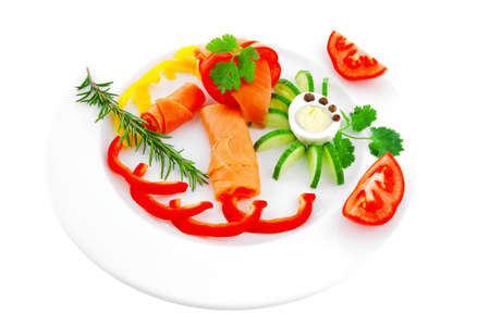diet healthy food - smoked sea salmon rolls with vegetables and egg on plate isolated over white background Stock Photo