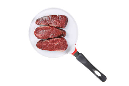 three fresh raw marble beef meat sirloin porterhouse steak on big ceramic cooking pan isolated on white background Stock Photo