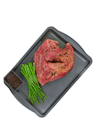 meat raw beef fillet chunk on black tray asparagus allspice isolated on white background empty space for text Reklamní fotografie
