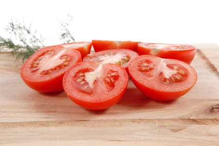 fresh raw tomatoes on light wooden plate isolated over white background Stock fotó