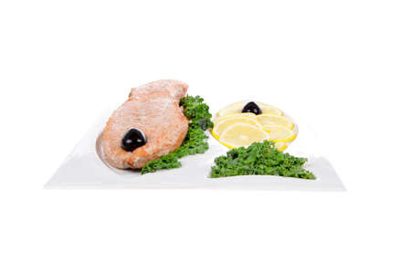 healthy food - fresh roast red fish salmon with kale lemon and black olives on plate isolated on white background space for text Stock fotó