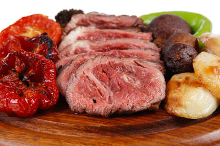 fresh grilled bbq beef meat rib eye steak on wooden plate with baked tomatoes mushroom, potatoes, hot chili pepper isolated on white backgrodun empty space for text Stock fotó