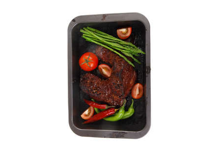 fresh glazed baked big beef meat rib chunk under sweet sauce with tomatoes hot chili pepper pink peppercorn and asparagus in black tray isolated on white background Stock fotó - 97206150
