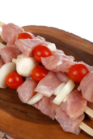 fresh raw meat fillet shish kebab turkey pork pink on skewers tomatoes mushrooms on wooden kitchen plate isolated over white background Stock fotó - 97206153