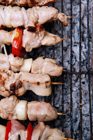 fresh turkey pink brisket shish kebab on wooden skewers with tomatoes over barbecue brazier full burned charcoal Stock fotó - 97206199