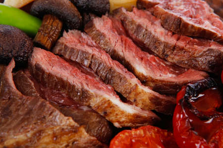 fresh grilled bbq beef meat rib eye steak on wooden plate with baked tomatoes mushroom, potatoes, hot chili pepper isolated on white backgrodun Stock fotó - 97206480
