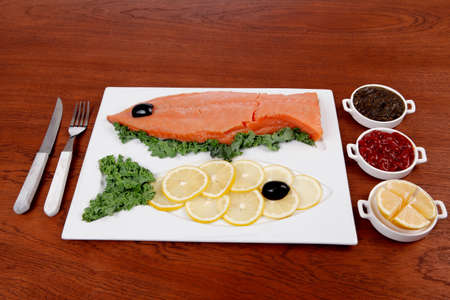 healthy food fresh raw red fish with kale lemon antipesto ketchup sauce on white plate over wooden table Stock fotó - 97206622