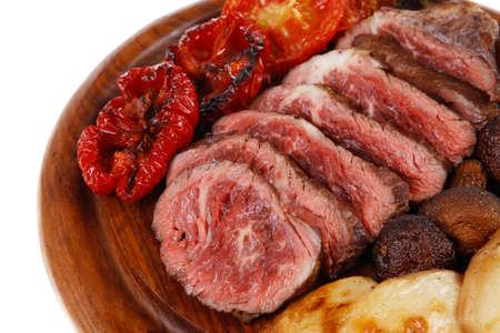 fresh grilled bbq beef meat rib eye steak on wooden plate with baked tomatoes mushroom, potatoes, hot chili pepper isolated on white backgrodun empty space for text Stock fotó - 97206636