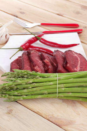fresh beef meat slices asparagus spices cutlery wooden table pepper hot chili vegetables served garlic light cutting board ready to cook Stock fotó - 97207145