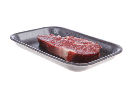fresh raw marble beef meat steak on black plastic market tray isolated on white background Stock fotó
