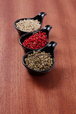 fresh dry peppercorn in small black bowl on wooden table ready to cook Stock fotó - 97206900