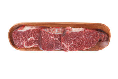 three fresh raw marble beef meat sirloin porterhouse steak on long wooden tray isolated on white background Stock fotó