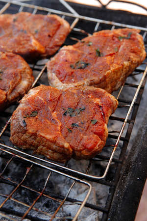 fresh beef meat fillet steak on barbecue grill grid cooked over burned charcoal ready Stock fotó