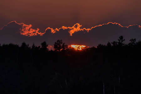 Sunset behind bank of clouds in Northern Wisconsin