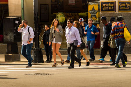 CHICAGO - May 29, 2019: People of Chicago crossing West Monroe Street and South Wabash Avenue. Редакционное