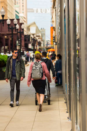 CHICAGO - May 29, 2019: Pedestrians on South Wabash Avenue in the Chicago Loop. Редакционное