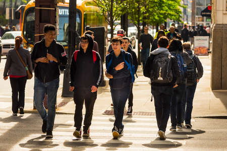CHICAGO - May 29, 2019: A group of young men cross South Wabash Street in Chicago.