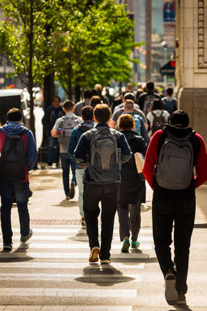 CHICAGO - May 29, 2019: Students cross South Wabash Avenue on East Jackson Boulevard in Chicago.