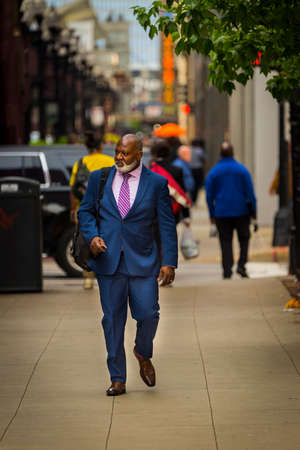 CHICAGO - May 29, 2019: A well-dressed man walks along South Wabash Avenue in Chicago.