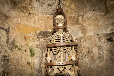 skeleton in torture chamber Stock Photo