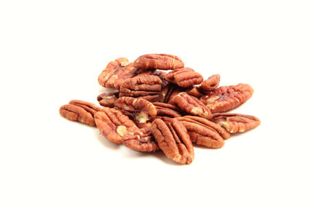 focus stacking: heap of pecan nuts on white background