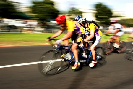 bicycle race: Tandem Cyclists competing at high speed with motion blur Stock Photo