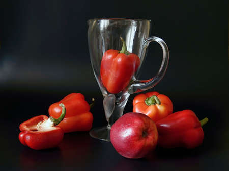 Red pepper, Apple and glass jug. Stock Photo