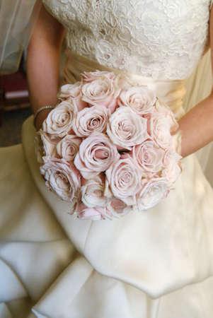 Close-up bride holding bouquet