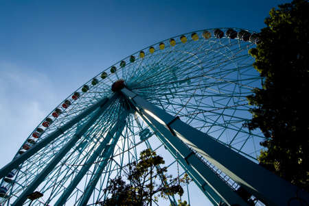 thrilling: Image of a Ferris wheel from dramatic low angle against sky