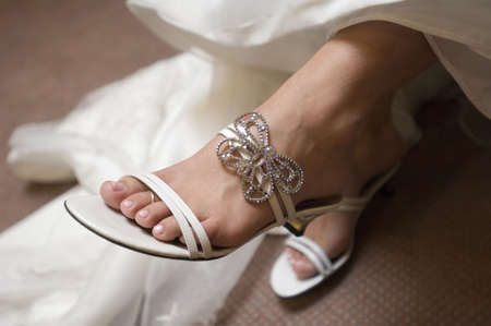 Image of a brides shoes with a diamond accent