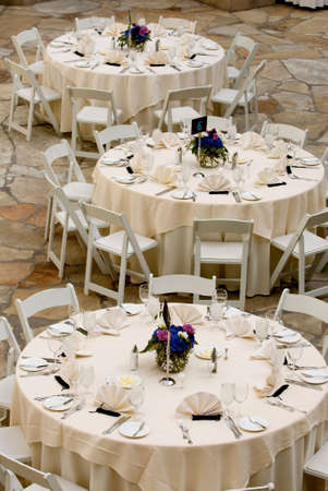 image of tables set for an event, party or wedding reception  photo
