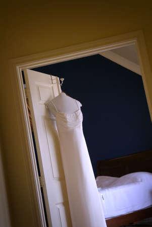 WEDDING GOWN HANGING ON DOOR Stock Photo - 2630808