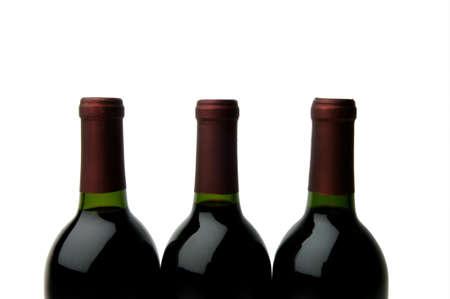 3 wine bottle tops on white background