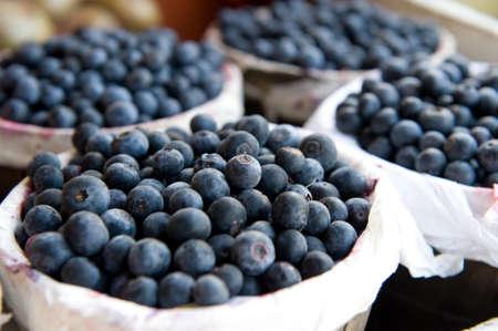 An image of bushels full of freshly picked blueberries Stock Photo