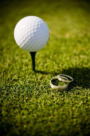 An abstract image of  rings lying next to a olf ball on a tee Stock Photo - 3275508