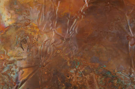 grunge textures: An abstract image of rainbow hued copper