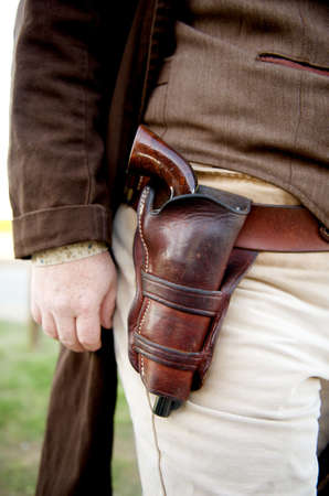 Image close up of a gun in a holster strapped to a cowboy Stock Photo - 3275522