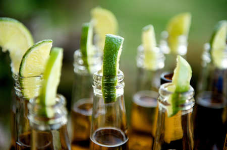 Close up image of multiple beer bottles with limes inserted Stock Photo - 3275507