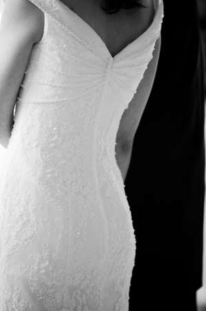 A black and white image of a bride in her gown