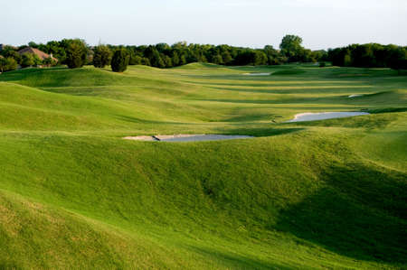 An image of a vibrant green golf course Stock Photo