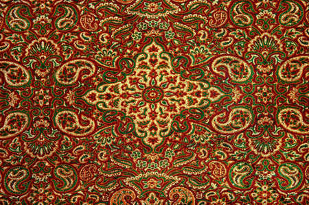 An up close image of a detailed Persian carpet Stock Photo