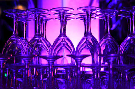 An image of purple hued stacked wine glasses photo