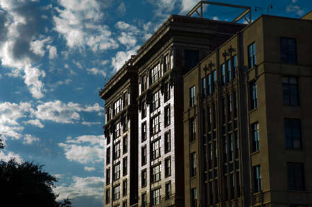 Dramatic image of sun reflecting off of an old building against blue sky Stock Photo - 4274304