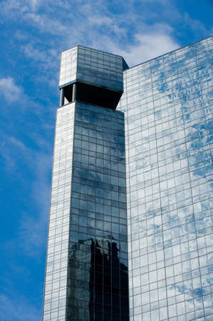 Image of the top corner of a modern glass skyscraper Stock Photo - 4982800