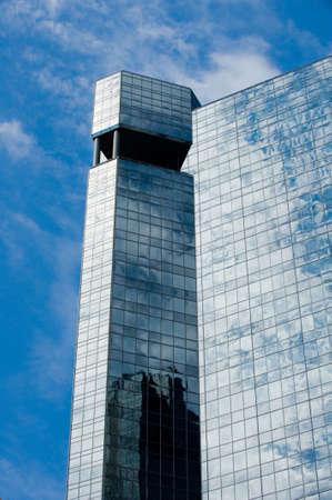 Image of the top corner of a modern glass skyscraper Stock Photo - 4982800